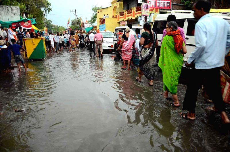 Rains lash Ujjain during Ardh Kumbh Mela on Akshay Tritiya in Ujjain on May 9, 2016.