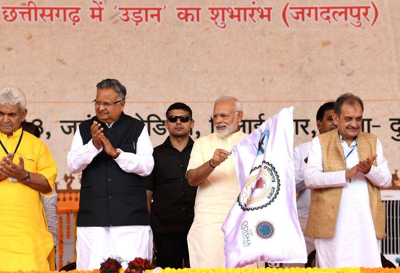 : Raipur: Prime Minister Narendra Modi inaugurates the air services between Jagdalpur and Raipur, at a function in Bhilai, Raipur, on June 14, 2018. Also seen Union Steel Minister  Chaudhary ...