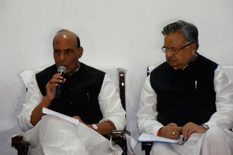 Union Home Minister Rajnath Singh addresses a press conference in Raipur after paying tribute to the 13 CRPF troopers gunned down by Maoists on Monday (1st December) in a thickly forested ... - Raman Singh