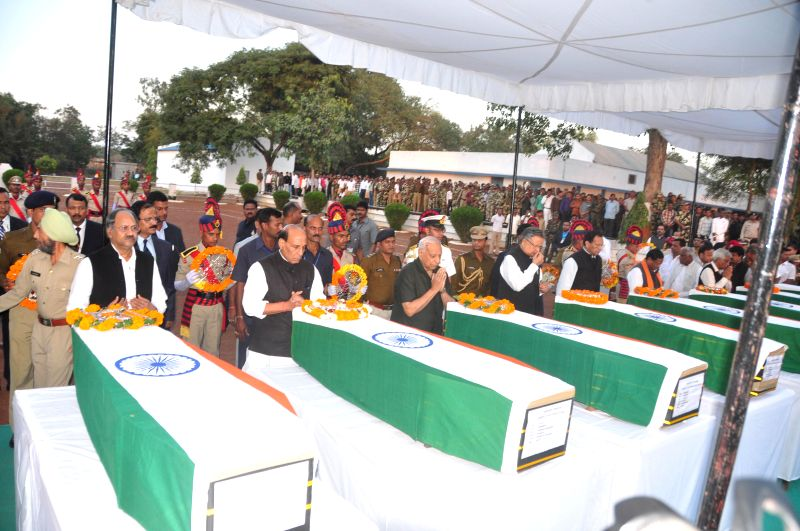Union Home Minister Rajnath Singh pays tribute to the 13 CRPF troopers gunned down by Maoists on Monday (1st December) in a thickly forested area of Chhattisgarh, on Dec 2, 2014. Also seen ... - Raman Singh