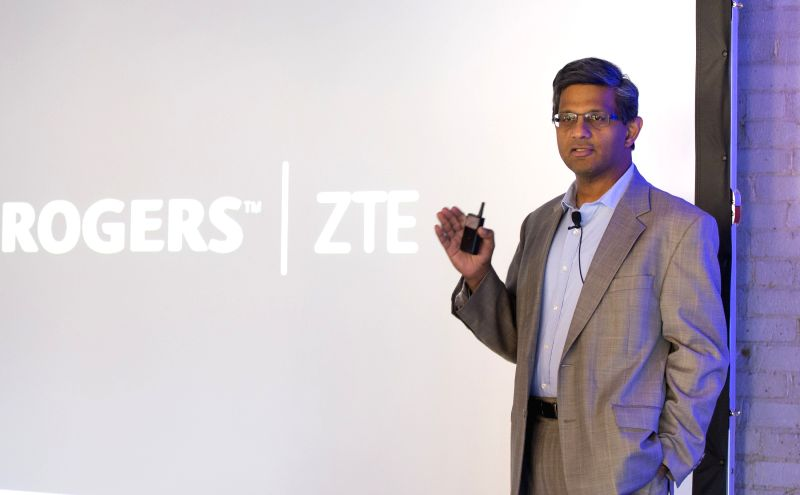 Raj Doshi, executive vice president of Canadian Wireless Consumer Services of Rogers Communications, delivers a speech during the official launch ceremony for ...