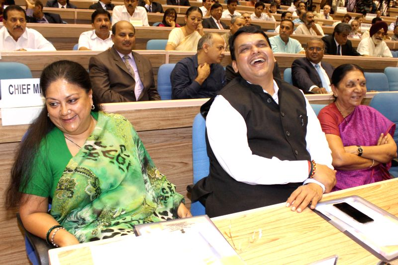 Rajasthan Chief Minister and BJP leader Vasundhara Raje, Maharashtra Chief Minister Devendra Fadnavis and Gujarat Chief Minister Anandiben Patel at the launch of the Skill India Mission, ... - Devendra Fadnavis and Anandiben Patel