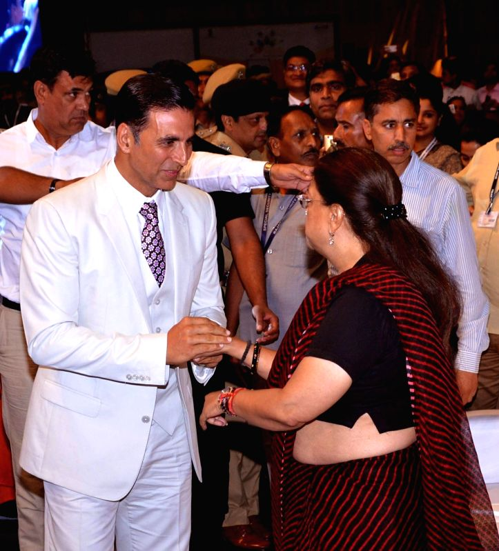 "Rajasthan Chief Minister Vasundhara Raje with actor Akshay Kumar during ""The Festival of Education"" in Jaipur on Aug 5, 2017. - Vasundhara Raje and Akshay Kumar"