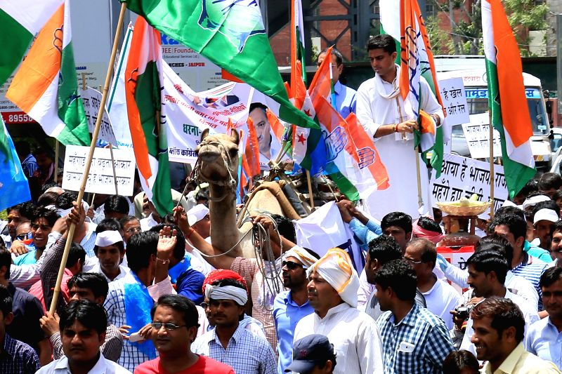 Rajasthan Congress chief Sachin Pilot rides a camel cart during a demonstration against hike in fuel prices and Rail budget 2014-15 in Jaipur on July 9, 2014.