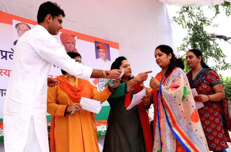 Rajasthan Congress President Sachin Pilot with newly joined party workers during a programme in Jaipur on Aug 14, 2014.