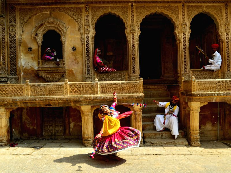 Folk artists perform at Patwa Haveli in Jaisalmer of Rajasthan on April 3, 2015.