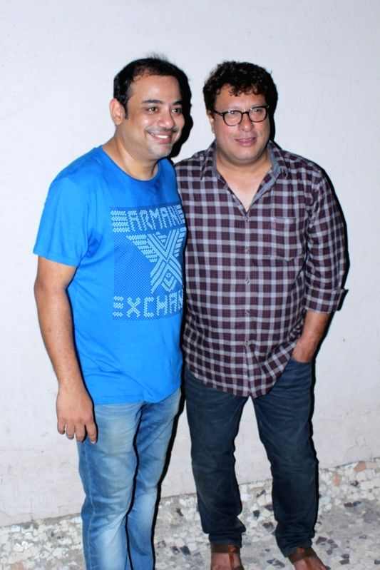 Rajesh Roy and filmmaker Tigmanshu Dhulia during the bis Birthday Party in Mumbai on April 11, 2017. - Rajesh Roy