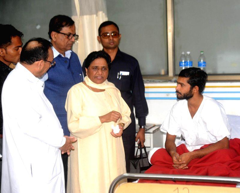 Rajkot : BSP supremo Mayawati meets Dalit victims of Una's village at Rajkot Civil hospital in Rajkot, on Aug 4, 2016.