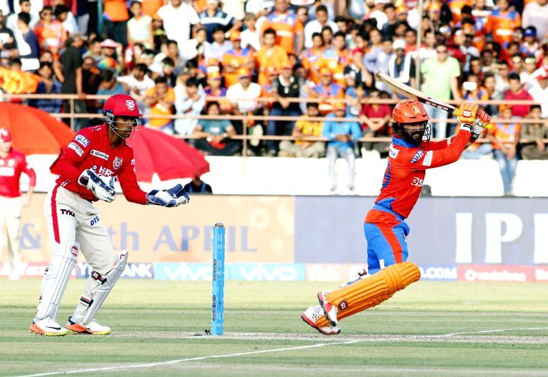 Rajkot : Dinesh Karthik of Gujarat Lions plays a shot during an IPL 2017 match between Gujarat Lions and Kings XI Punjab at Saurashtra Cricket Association Stadium in Rajkot on April 23, 2017.