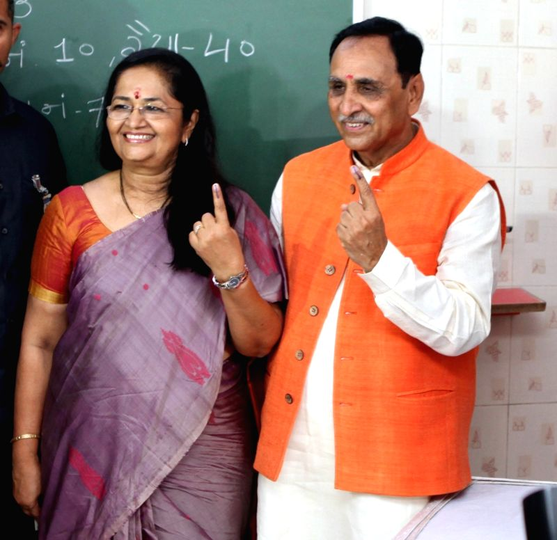 Rajkot (Gujarat): Gujarat Chief Minister Vijay Rupani and his wife Anjali Rupani show their inked fingers after casting their votes for the third phase of 2019 Lok Sabha elections in Gujarat's Rajkot, on April 23, 2019. (Photo: IANS)