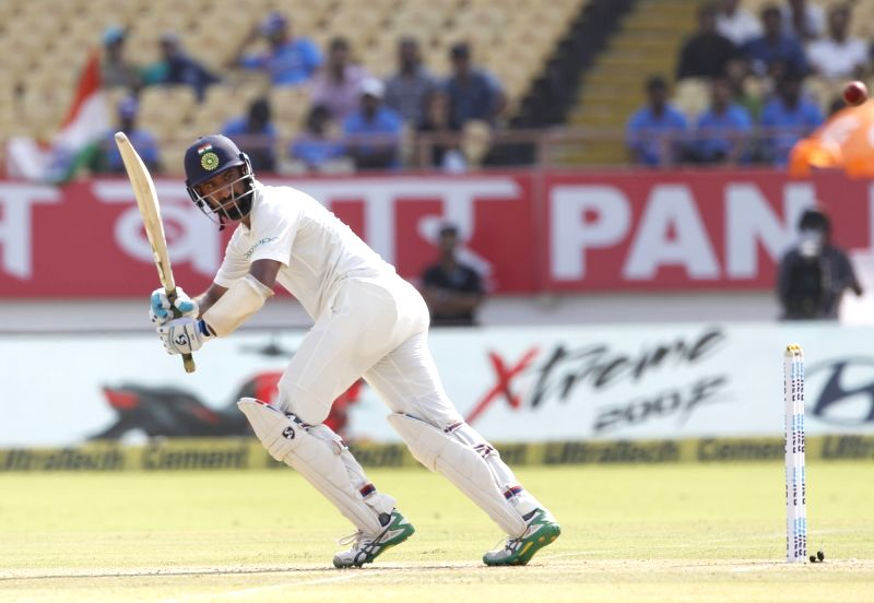 :Rajkot: India's Cheteshwar Pujara in action during the 1st Test match between India and West Indies at Saurashtra Cricket Association Stadium in Rajkot on Oct 4, 22018. (Photo: Surjeet ...(Image Source: IANS)