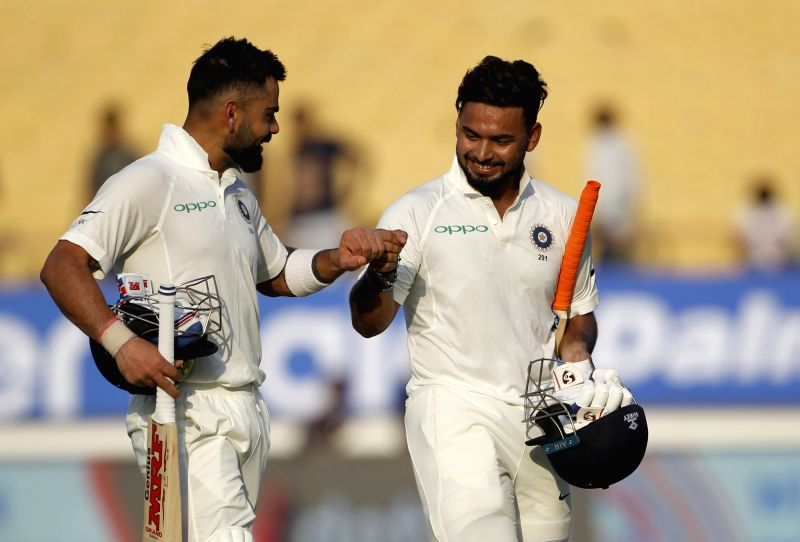 Rajkot: Indian captain Virat Kohli and Rishabh Pant return back to the pavilion after the end of first day's match during the 1st Test match between India and West Indies at Saurashtra Cricket Association Stadium in Rajkot on Oct 4, 22018. (Photo: Su