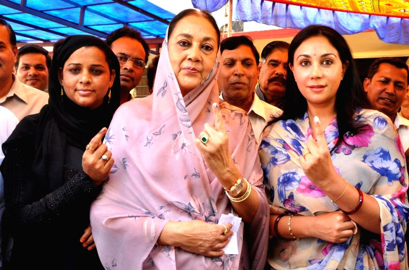 Rajmata Padmini Devi and Princess Diya Kumari showing their ink-marked finger after casting their vote during the fifth phase of Lok Sabha election in Jaipur on April 17,2014.