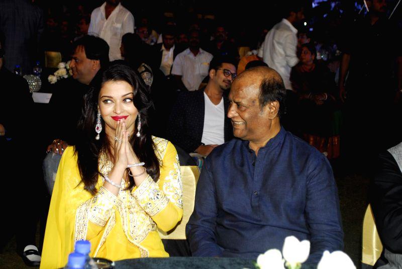 Rajnikanth and Aishwarya Rai Bachchan during the trailer launch of upcoming film Shamitabh and celebration of 1000 film of music composer Ilaiyaraaja in Mumbai on 20th Jan 2015. - Aishwarya Rai Bachchan