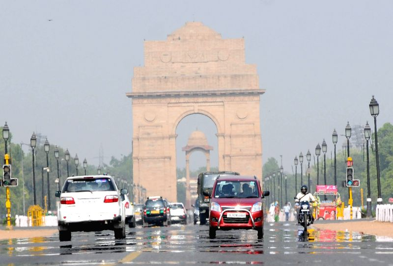 A mirage appears on Rajpath on a hot afternoon in New Delhi on May 1, 2015.