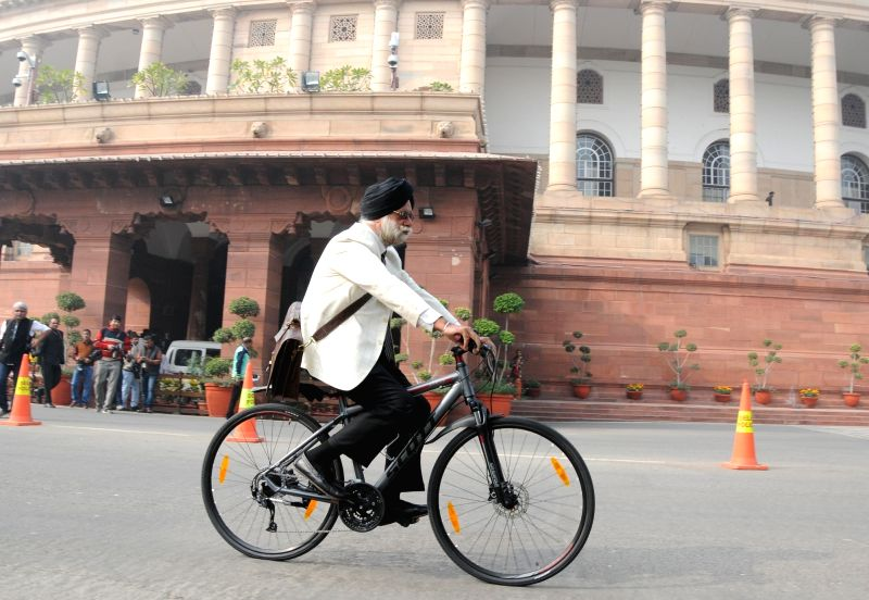 Rajya Sabha member  KTS Tulsi arrives at the Parliament riding a cycle in New Delhi, on Dec 8, 2015.
