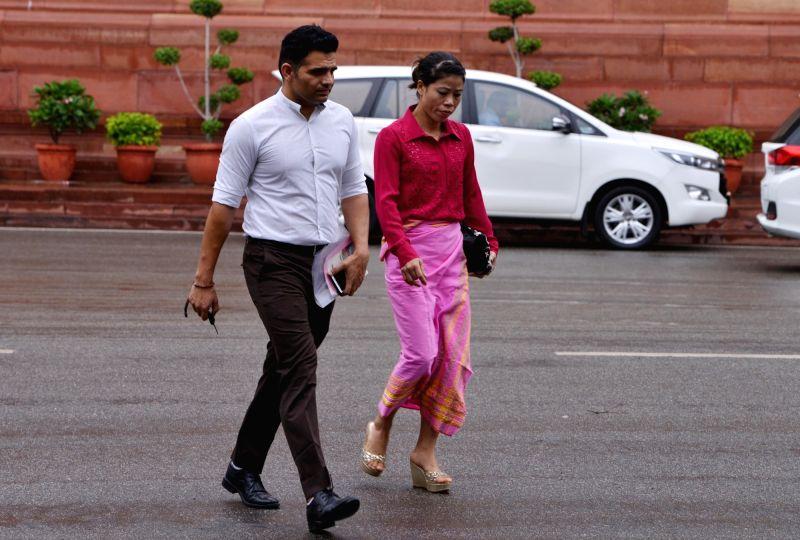 Rajya Sabha MP MC Mary Kom (R) at Parliament in New Delhi, on Aug 6, 2018. - Mary Kom