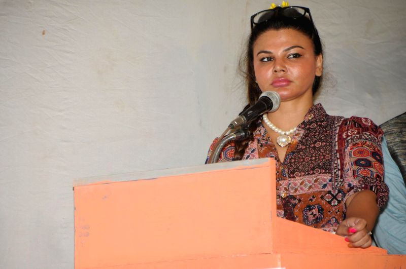 Rakhi Sawant with Cyril D`Souza during the Distribution of Sewing Machines to supports the cause of women empowerment an initiative by `Awaz Samajik Sanstha`of Cyril D`Souza in Mumbai, on Aug. 17, ...