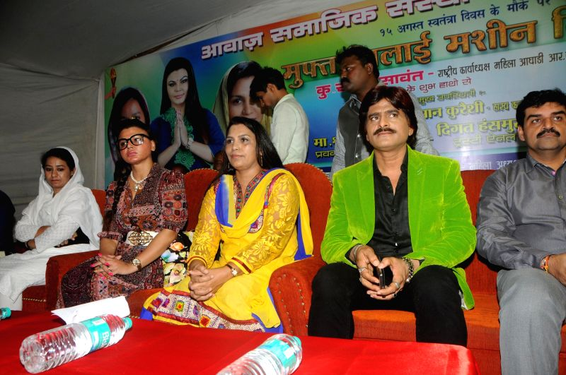 Rakhi Sawant with Ehsaan Qureshi during a celebration on Women Empowerment initiative by `Awaz Samajik Sanstha`of Cyril D`Souza in Mumbai, on Aug. 17, 2014.