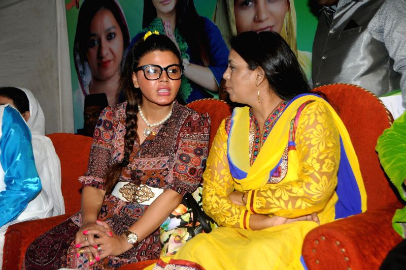 Rakhi Sawant with Zeenat Qureshi during a celebration on Women Empowerment initiative by `Awaz Samajik Sanstha`of Cyril D`Souza in Mumbai, on Aug. 17, 2014.