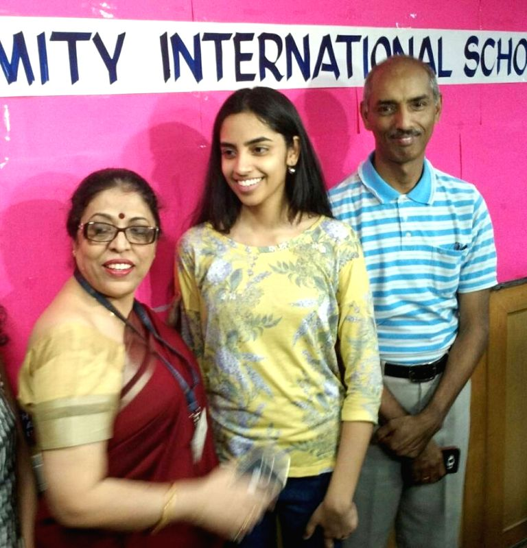 Raksha Gopal, who topped the Class 12 CBSE exams, the results of which were declared on May 28, 2017 celebrates with her parents in Noida.