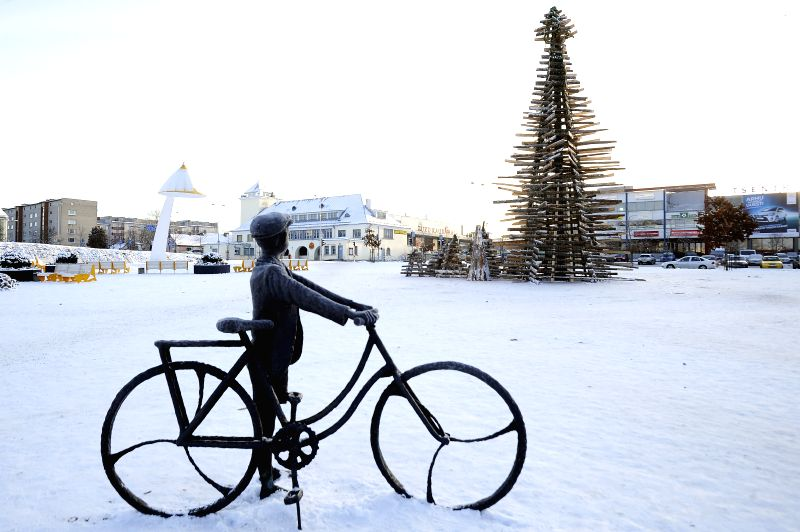 A over-ten-metre high Christmas tree built with waste wood is placed by local students at the city centre of Rakvere, Western Virumaa county of Estonia, Dec. 3, 2014. Local young students of