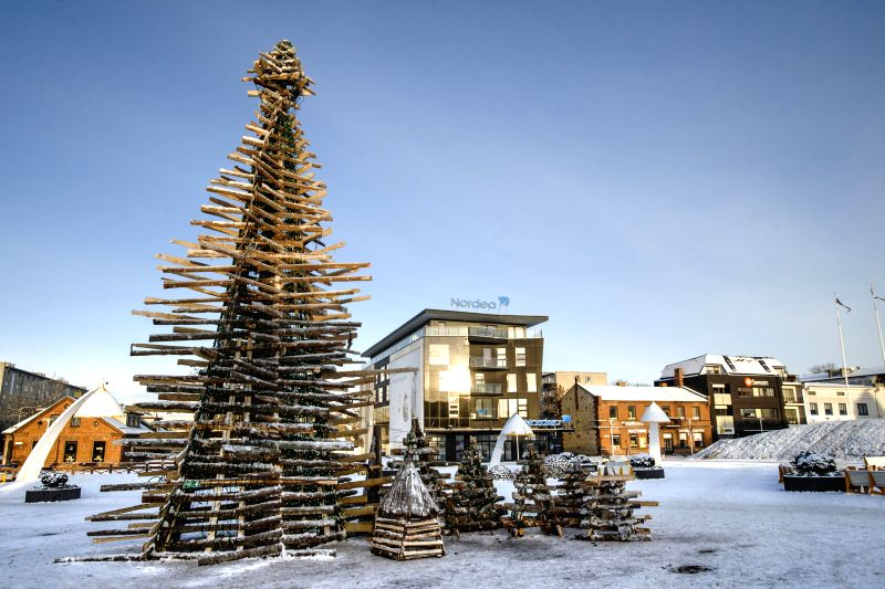 A over-ten-metre tall Christmas tree built with waste wood is placed by local students at the city centre of Rakvere, Western Virumaa county of Estonia, Dec. 3, 2014. Local young students of