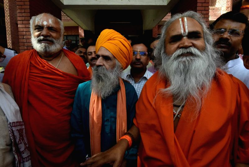 Ram Vilas Vedanti, Champat Rai and BL Sharma leave after getting bail in Babri Masjid case by special CBI court in Lucknow on May 20, 2017. - Champat Rai