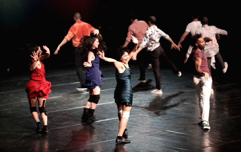 """Dancers perform """"Badkeh"""" show during the final eve of Ramallah Contemporary Dance Festival in the West Bank city of Ramallah on April 29, 2014."""