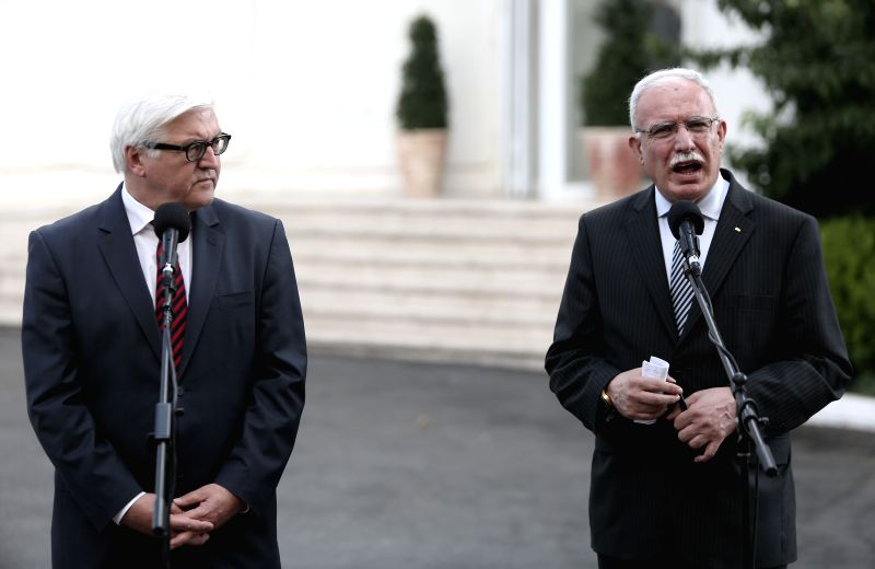 Palestinian Foreign Minister Reyad al-Malki (R) talks during the press conference with German Foreign Minister Frank-Walter Steinmeier during their meeting in the - Reyad
