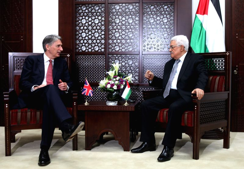 Palestinian President Mahmoud Abbas (R) meets with British Foreign Secretary Philip Hammond in the West Bank city of Ramallah, on July 23, 2014. (Xinhua/Fadi ...