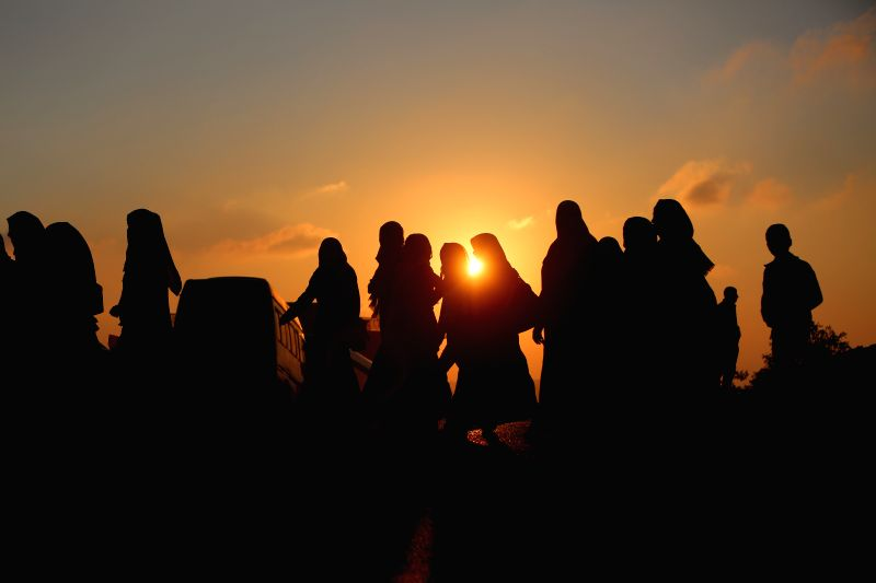 RAMALLAH, June 3, 2017 - Palestinians cross through Israeli Qalandia checkpoint as they make their way to attend the first Friday prayer of the holy month of Ramadan in Jerusalem's al-Aqsa mosque, ...