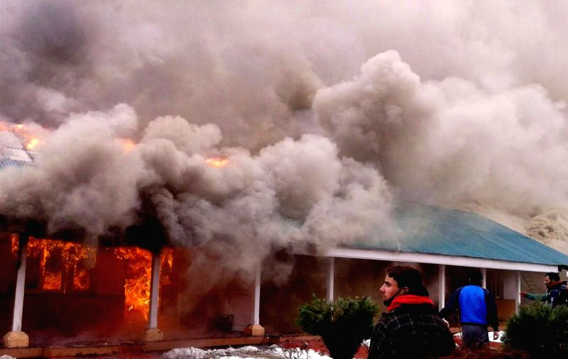 A fire breaks out at an over 80-year-old government dak bunglow (rest house) in Jammu and Kashmir's Ramban district on Feb 8, 2015.