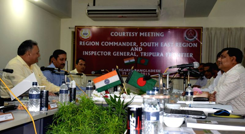 Ramgarh (Bangladesh): BSF Inspector General (Tripura Frontier) B N Sharma and Brigadier General Md. Habibul Karim of BGB during  meeting in Ramgarh area of Bangladesh on April 25, 2015. - B N Sharma