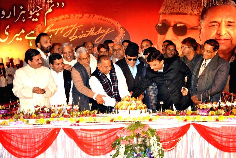 Samajwadi Party chief Mulayam Singh Yadav with Uttar Pradesh Chief Minister Akhilesh Yadav and party leader Azam Khan Khan during his 75th birthday celebration in Rampur, Uttar Pradesh on ... - Akhilesh Yadav and Azam Khan Khan