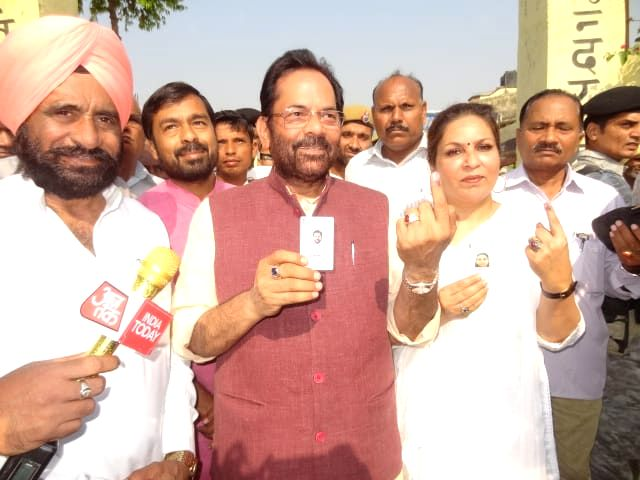 Rampur (UP): Union Minister and BJP leader Mukhtar Abbas Naqvi shows his inked finger after casting his vote for the third phase of 2019 Lok Sabha elections in Uttar Pradesh's Rampur, on April 23, 2019. (Photo: IANS/ECI)