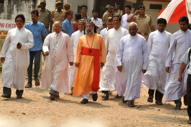 Catholic Bishops' Conference president Cardinal Baselios Cleemis (safron robe) leads a two-member delegation to Ranaghat of West Bengal on March 18, 2015. A 71-year-old nun nun was gang ...