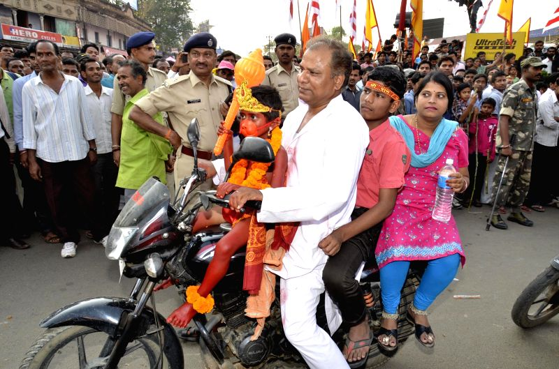 A child devotee dressed as Lord Hanuman being carried by his father on motorcycle on the occasion of Ram Navami in Ranchi on March 28, 2015.