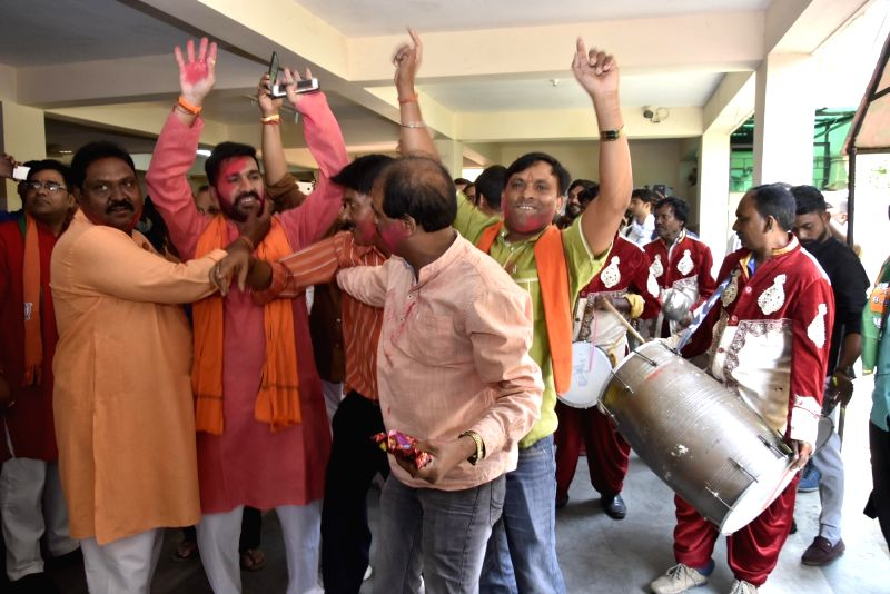 Ranchi: BJP workers celebrate after the counting trends show that the party appeared set to retain power as its candidates led in most of the 542 Lok Sabha constituencies, in Ranchi on May 23, 2019. (Photo: IANS)
