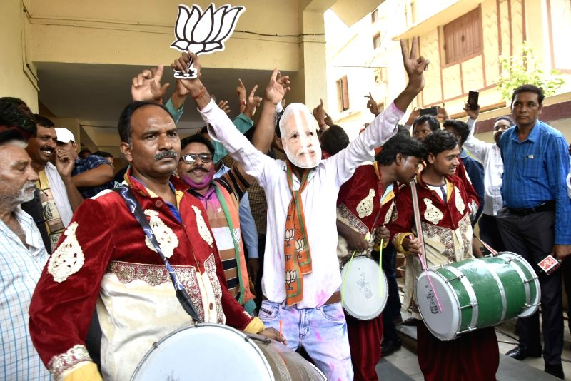 Ranchi: BJP workers celebrate at the party office after the counting trends show that the party appeared set to retain power as its candidates led in most of the 542 Lok Sabha constituencies, in Ranchi on May 23, 2019. (Photo: IANS)