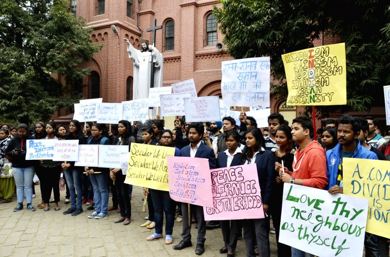 Christians demonstrate against the burning of St. Sebastian`s Church at Delhi`s Dilshad Garden earlier this month at St.Mary's Cathedral in Ranchi on Dec. 13, 2014.