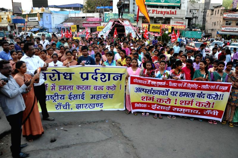 Christians stage a demonstration to condemn the recent gang rape of a nun in Ranaghat of West Bengal`s Nadia district, in Ranchi on March 17, 2015.