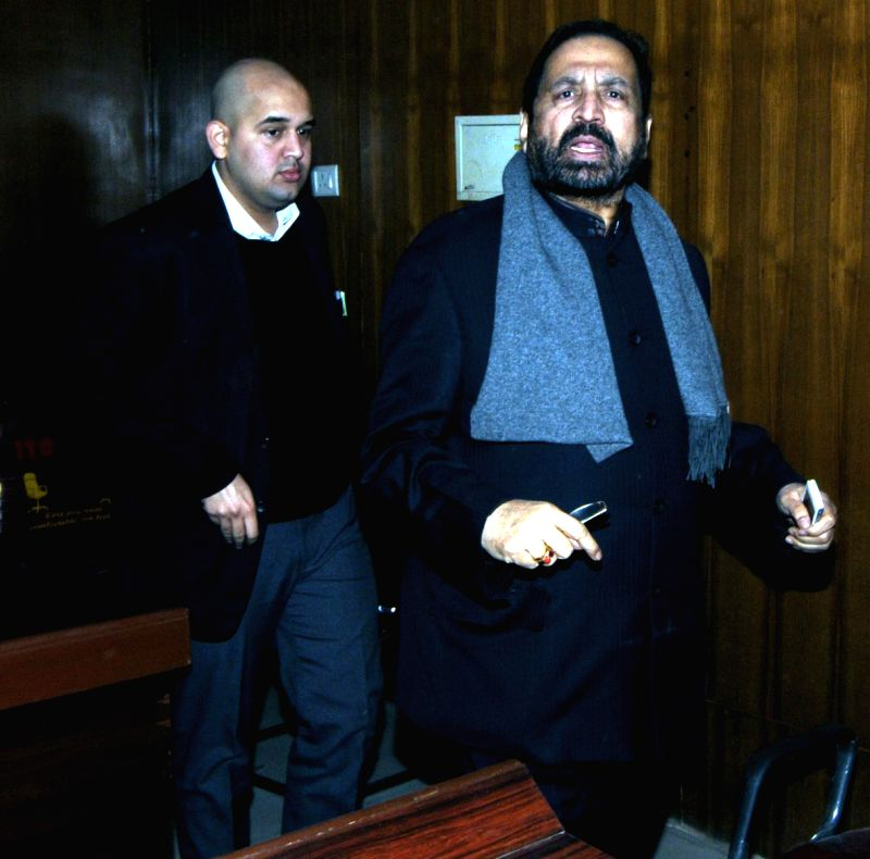 Former Indian Olympic Association (IOA) president Suresh Kalmadi arrives to appear before Jharkhand Vigilance Bureau in Ranchi, on Dec 22, 2014.