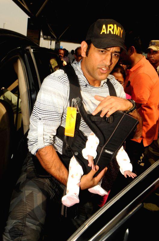 Indian cricket captain MS Dhoni alongwith his daughter Ziva arrives at Birsa Munda Airport in Ranchi, on April 4, 2015. - Birsa Munda Airport