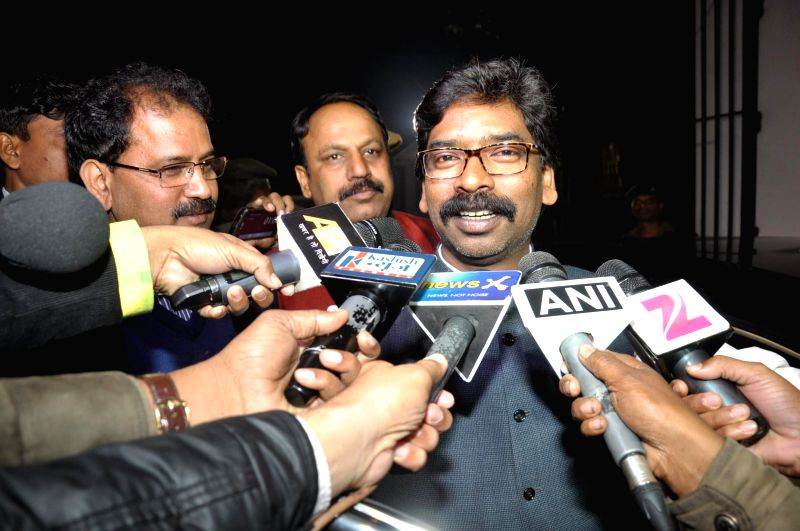 Jharkhand Chief Minister Hemant Soren addresses press  after tendering his resignation to Jharkhand Governor Syed Ahmad at Governor House in Ranchi, on Dec 23, 2014.