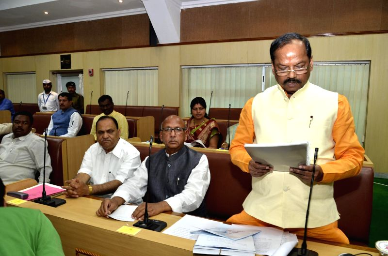 Jharkhand Chief Minister Raghuwar Das presents the annual budget 2015-2016 for the state at Jharkhand Legislative Assembly in Ranchi, on March 3, 2015. - Raghuwar Das