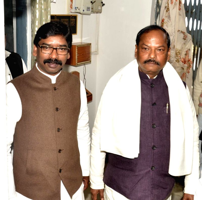 Jharkhand Chief Minister Raghuwar Das with former Jharkhand chief minister Hemant Soren on the first day of Jharkhand Assembly session in Ranchi, on Jan 6, 2015.