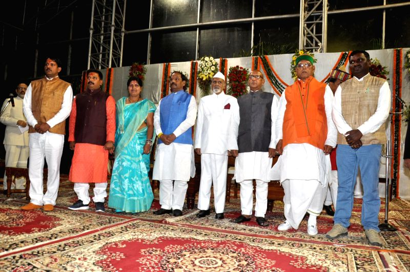 Jharkhand Governor Syed Ahmed, Jharkhand Chief Minister Raghuwar Das and the newly appointed cabinet ministers during a swearing-in ceremony at Raj Bhawan in Ranchi on Feb 19, 2015. - Raghuwar Das