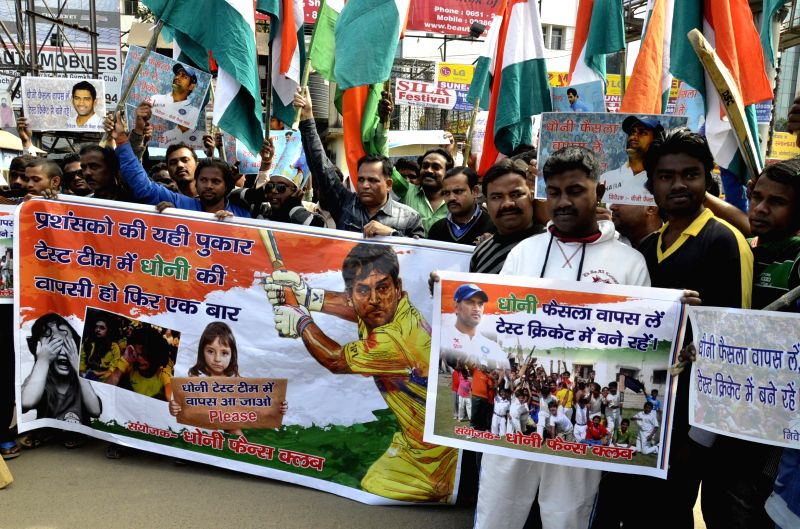 Members of Dhoni fans club participate in a rally in support of Indian cricketer Mahendra Singh Dhoni after he announced retirement, in Ranchi, on Dec 31, 2014. - Mahendra Singh Dhoni