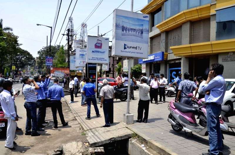 People rush out of their offices as tremors were felt in Ranchi on April 25, 2015. According to the India Meteorological Department, the depth of earthquake was 10 km and measured 6 on the ...